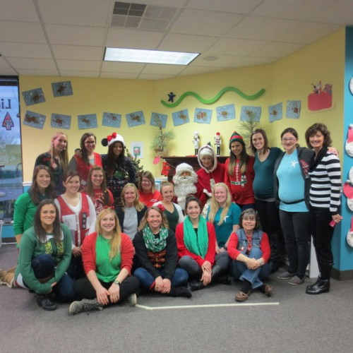 Staff gather for a photo with Mr. and Mrs. Clause