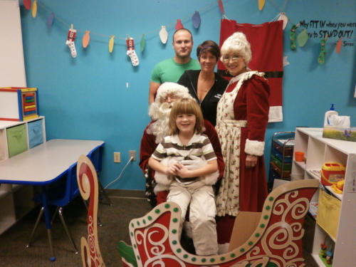 One of our kiddos in Warsaw with his parents and Mr. and Mrs. Clause